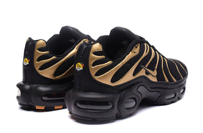 nike tn air max txt chaussures de running maille or